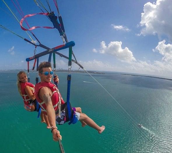Farm Bureau agent and guest enjoy parasailing in Kauai.